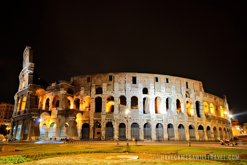 A night shot of the famous and historic Roman Coliseum in Rome, Italy, with lights.