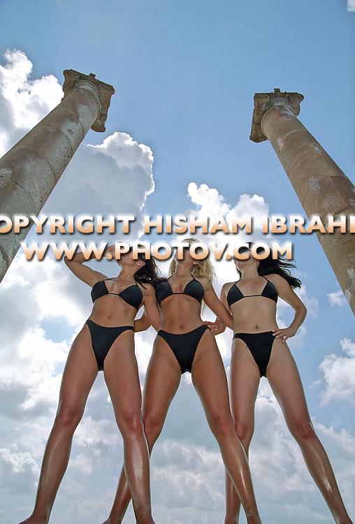 Three sexy women in bikini having fun on the beach, Cancun, Mexico