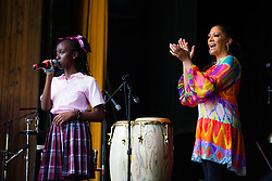 Shakere Gilbert, of Ivanna Eudora Kean High School sings for the audience.  Sheila E. conducts the latest Arts in Education residency for K-12 students at the Reichhold center.  Students shared their talent for drums, singing, and dancing and learned about the types of instruments and sounds that Sheila E. is known for.  Sheila E. will be performing at the Reichhold center on Saturday, October 5th at 8pm.  4 October 2013.  Reichhold Center.  St. Thomas, USVI.  © Aisha-Zakiya Boyd
