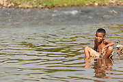 A boy plays in the river in San Esteban, Honduras on Thursday April 25, 2013.