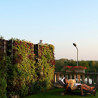 A couple relaxing in the garden of the Relais & Chateaux La Cote Saint-Jacques in Joigny.
