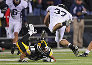 October 2 2010: Iowa Hawkeyes cornerback Micah Hyde (18) hits Penn State Nittany Lions running back Joe Suhey (37) during the first half of the NCAA football game between the Penn State Nittany Lions and the Iowa Hawkeyes at Kinnick Stadium in Iowa City, Iowa on Saturday October 2, 2010. Iowa defeated Penn State 24-3.