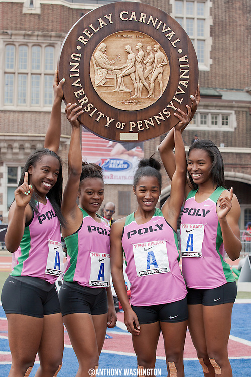 Athletes from Long Beach Poly High School (California) pose for photos after winning the High School Girls' 4x100 Championship of America at the Penn Relays athletic meets on Friday, April 27, 2012 in Philadelphia, PA.
