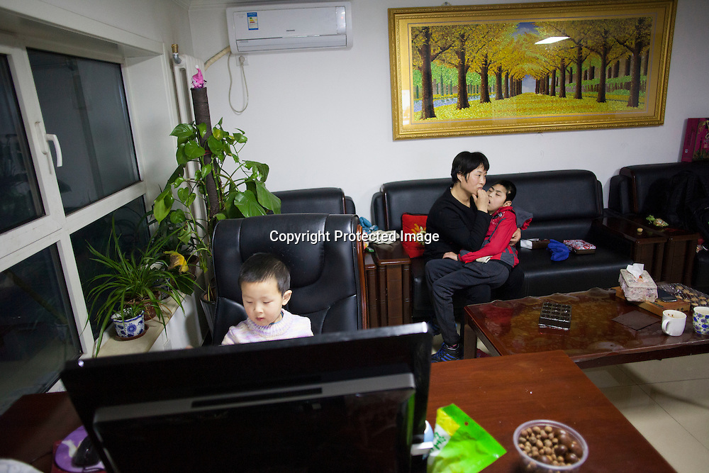 Beijing, March 11 : Tian Peng, 15, is taken care of by his mother Cui Xinying while his little brother Tian Ye, 3, plays in the apartment.<br /> As a baby Tian Peng fell ill with brain   hemorrhage supposedly due to a lack of vitamin K. When Tian Peng was a kid, friends advised the parents to simply abandon him as there's neither enough help nor support in China apart from a small NGO. Tian is unable to speak, think, walk and needs help for everything.<br /> Chinese attitudes towards people with disabilities have improved in recent years, but the support of society and opportunities in education and employment are scarce.