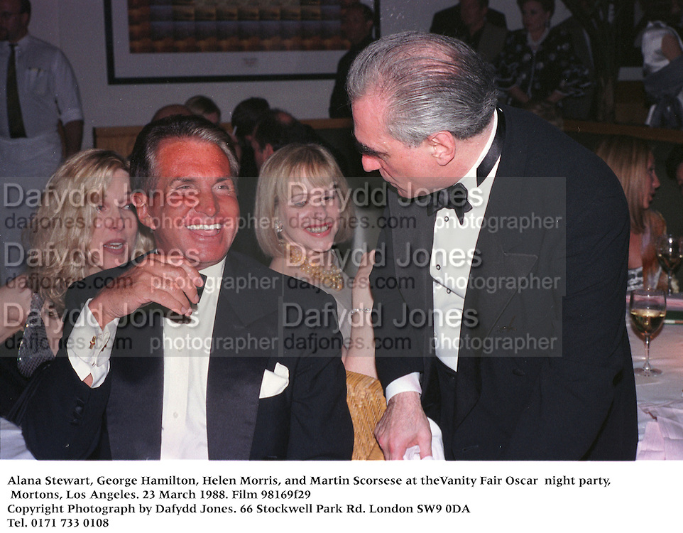 Alana Stewart, George Hamilton, Helen Morris, and Martin Scorsese at theVanity Fair Oscar  night party, Mortons, Los Angeles. 23 March 1988. Film 98169f29<br />