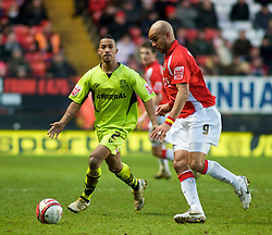 LONDON, ENGLAND - Saturday, January 30, 2010: Charlton Athletic's Leon McKenzie is closed down by Tranmere Rovers' Shaleum Logan during the Football League One match at the Valley. (Photo by Gareth Davies/Propaganda)