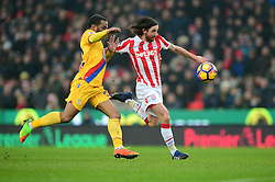 Joe Allen of Stoke City chases down the ball under pressure from Jason Puncheon of Crystal Palace - Mandatory by-line: Alex James/JMP - 11/02/2017 - FOOTBALL - Bet365 Stadium - Stoke-on-Trent, England - Stoke City v Crystal Palace - Premier League