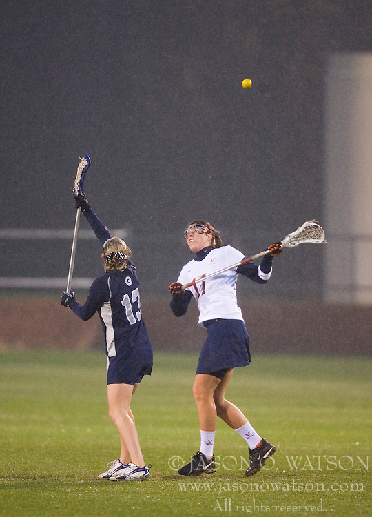 Virginia Cavaliers M Brittany Kalkstein (17) on a draw against Georgetown Hoyas Coco Stanwick (13).  The Virginia Cavaliers Women's Lacrosse team hosted the Georgetown Hoyas at Klockner Stadium in Charlottesville, VA on April 11, 2007.  UVA lead GU 7-3 with 2:45 remaining in the first half.