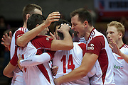 (R) Bartosz Kurek celebrates with team mates after winning point during the 2013 CEV VELUX Volleyball European Championship match between Poland and Turkey at Ergo Arena in Gdansk on September 20, 2013.<br /> <br /> Poland, Gdansk, September 20, 2013<br /> <br /> Picture also available in RAW (NEF) or TIFF format on special request.<br /> <br /> For editorial use only. Any commercial or promotional use requires permission.<br /> <br /> Mandatory credit:<br /> Photo by &copy; Adam Nurkiewicz / Mediasport