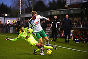 Hartlepool United defender Carl Magnay (2) tackles Bognor Regis Town forward Jimmy Wild (9) during the Ryman Premier League match between Bognor Regis Town and Havant & Waterlooville FC at Nyewood Lane, Bognor, United Kingdom on 26 December 2016. Photo by Jon Bromley.