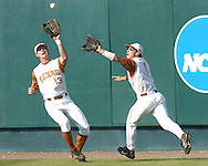 Texas outfielders Nick Peoples (1) and Drew Stubbs (13) converge on the fly ball in the bottom of the first inning.  Baylor defeated Oregon State 4-3 in ten innings and eliminated OSU from the College World Series at Rosenblatt Stadium in Omaha, Nebraska on June 20, 2005.
