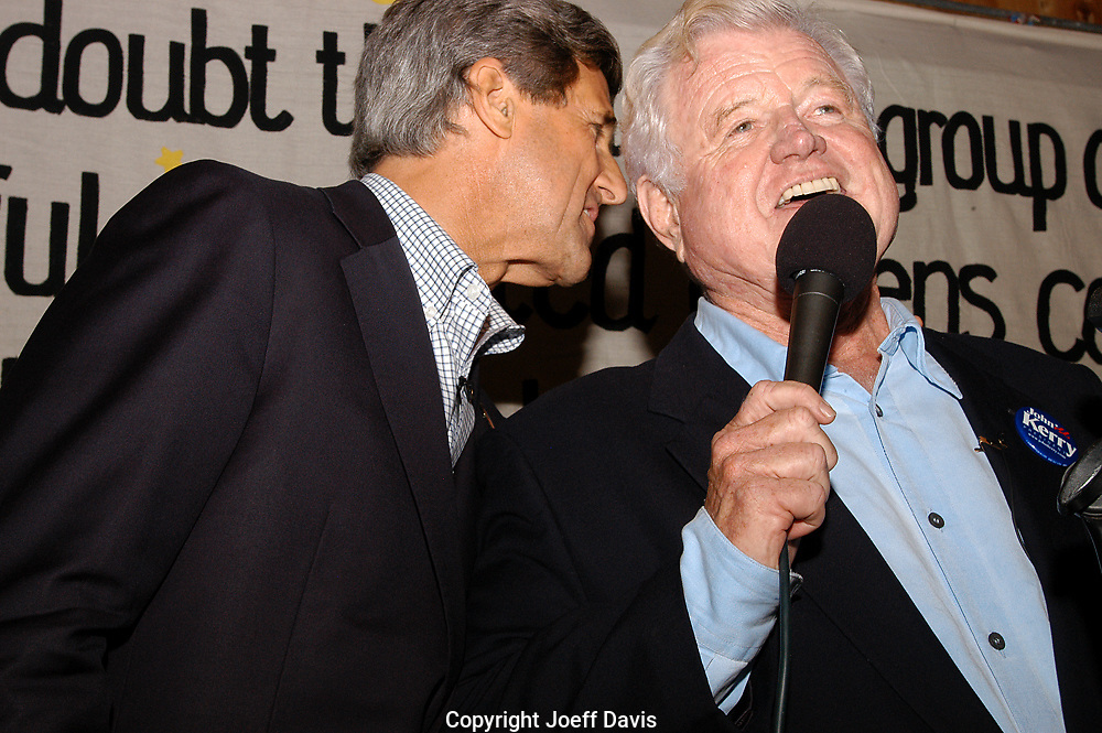 IOWA CITY, IA - SEPTEMBER 27, 2003: Senator John Kerry of Massachusetts whispers into the ear of Senator Ted Kennedy of Massachusetts during a campaign stop for Kerry's bid for the 2004 Democratic presidential nomination.