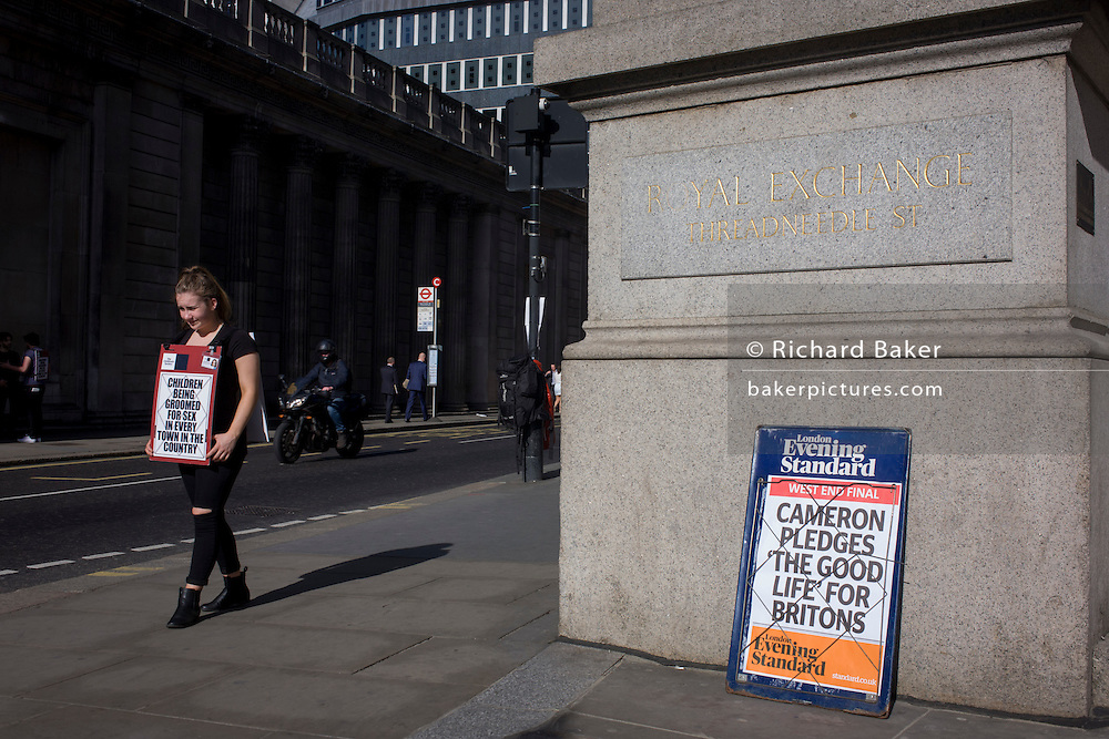 "Campaigner for the Childrens' Society waits for new donors next to David Cameron's Conservative party's election promise on Evening Standard headline in the City of London. David Cameron has said his aim is to guarantee a ""good life"" for British workers and families as he launched the Conservatives' election manifesto. The prime minister said he wanted ""to finish the job"" of rebuilding Britain on behalf of ""working people"". Labour said the Conservatives were the ""party of the richest in society""."