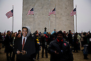 Obama Inauguration - Sunday concert on the National Mall, Washington monument and Lincoln Memorial. Cardboard cut-out of Obama in the crowd near the Washington Monument. Heavy security is seen in the background.