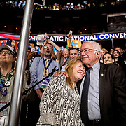 PHILADELPHIA, PA - JULY 26, 2016: Democratic presidential candidate Bernie Sanders embraces his wife Jane Sanders after delivering votes to suspend the rules of the Democratic National Convention to nominate his rival Hillary Rodham Clinton by acclimation.
