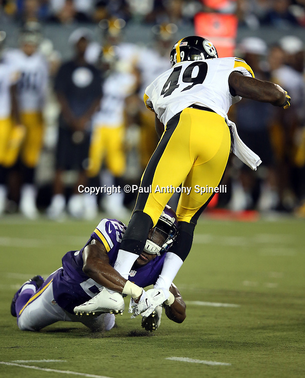 Pittsburgh Steelers linebacker Shayon Green (49) gets upended while running the ball by Minnesota Vikings cornerback Jabari Price (25) who loses his helmet on the tackle during the 2015 NFL Pro Football Hall of Fame preseason football game against the Minnesota Vikings on Sunday, Aug. 9, 2015 in Canton, Ohio. The Vikings won the game 14-3. (©Paul Anthony Spinelli)