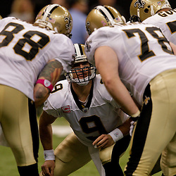 2009 October 04: New Orleans Saints quarterback Drew Brees (9) calls a play from the huddle during a 24-10 win by the New Orleans Saints over the New York Jets at the Louisiana Superdome in New Orleans, Louisiana.
