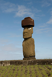 Chile, Easter Island: Statue or moai on a platform or ahu called Ahu Tahai near the town of Hanga Roa.  This statue is unique because it is the only one fully restored with a topknot and eyes..Photo #: ch211-33108.Photo copyright Lee Foster www.fostertravel.com lee@fostertravel.com 510-549-2202