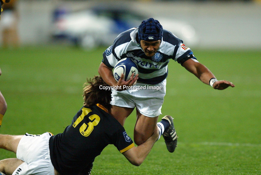 Auckland's Sam Tuitupou gets tackled by Lion's Conrad Smith during the Wellington Lions vs Auckland at the Westpac Stadium, Wellington, New Zealand. NPC Div 1 11 September 2004<br /> Photo: Marty Melville/Photosport