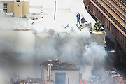 EAST HARLEM, NY - MAR 13, 2014 - Firefighters worked for hours to douse the blaze. Photo by Scott Klocksin/NYCity Photo Wire