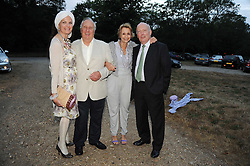 Left to right, EMMA KITCHENER-FELLOWES,FREDERICK & SANDY FORSYTH and JULIAN FELLOWES leaving a summer party hosted by Lady Annabel Goldsmith at her home Ormeley Lodge, Ham Gate, Richmond on 13th July 2010.