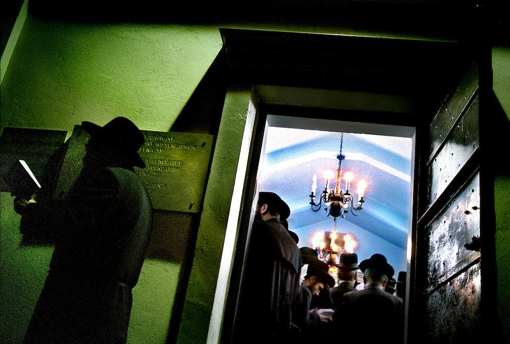 .030324-25 The 21 of Adar (usually in March) each year, tens of thousands hassidic jews from all over the world travel to the small town of Lezajsk in Poland. Most of them come in chartered airplanes from New York and Israel. They come to pray to the soul of Rabbi Elimelech, a holy man who died in Lezajsk 1787. In the 18th century Lezajsk was the center of hassidism in Poland. Today there are no hassidic jews left living here. The obejctive of the yearly pilgrimage is to pray to to the soul of Rabbi Elimelech which is believed to descend to Earth on the day of his death.  For those who are not allowed to enter burial grounds, tents for prayer are raised nearby. Women are not allowed in the central space of the tomb. Some of them pray by the outside walls, some pray in a designated room inside. The pilgrims gather by thousands in the small and incredibly crowded and overheated tomb and spend the entire night in fervent prayer, before they eat and quickly depart for the nearby airports in chartered buses ....030324-25 The 21 of Adar (usually in March) each year, tens of thousands hassidic jews from all over the world travel to the small town of Lezajsk in Poland. Most of them come in chartered airplanes from New York and Israel. They come to pray to the soul of Rabbi Elimelech, a holy man who died in Lezajsk 1787. In the 18th century Lezajsk was the center of hassidism in Poland. Today there are no hassidic jews left living here. The obejctive of the yearly pilgrimage is to pray to to the soul of Rabbi Elimelech which is believed to descend to Earth on the day of his death.  For those who are not allowed to enter burial grounds, tents for prayer are raised nearby. Women are not allowed in the central space of the tomb. Some of them pray by the outside walls, some pray in a designated room inside. The pilgrims gather by thousands in the small and incredibly crowded and overheated tomb and spend the entire night in fervent prayer, before they eat and quickly depart for