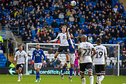 George Byers of Swansea City and Marlon Pack of Cardiff City jump for the ball during the EFL Sky Bet Championship match between Cardiff City and Swansea City at the Cardiff City Stadium, Cardiff, Wales on 12 January 2020.