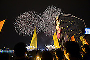 Celebrations for China's 60th anniversary, since Mao Zedong proclaimed the foundation of the People's Republic of China. People watched a major National Day fireworks display at Bai'etan section of the Pearl River, Shamian Island. It was the year's display the most elaborate and expensive one in recent years, costing 3.3 million Yuan. (October, 1st, 2009)