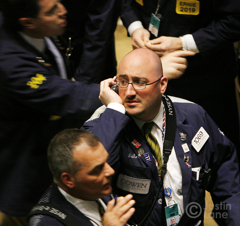 Traders work on the floor of the New York Stock Exchange at the end of trading in New York, New York on Tuesday 27 February 2007. The Dow Jones Industrial average ended down 3 percent after China's equity market tumbled today.