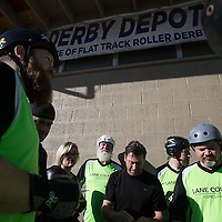 "Dick ""Merby Dick"" Roche joins his teammates on the Lane County Concussion in a bout against Glenmore Reservoir Dogs during the Testosterdome mens roller derby tournament, in Salt Lake City, Utah, on Saturday, November 8, 2014. Roche is 74, could be the oldest man competing in derby."