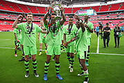 Forest Green Rovers Kaiyne Woolery(14) with the trophy as the players celebrate during the Vanarama National League Play Off Final match between Tranmere Rovers and Forest Green Rovers at Wembley Stadium, London, England on 14 May 2017. Photo by Shane Healey.