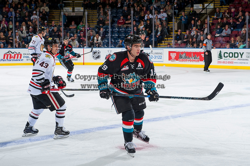 KELOWNA, CANADA - OCTOBER 20: Dillon Dube #19 of the Kelowna Rockets skates over the blue line ahead of Skyler McKenzie #43 of the Portland Winterhawks on October 20, 2017 at Prospera Place in Kelowna, British Columbia, Canada.  (Photo by Marissa Baecker/Shoot the Breeze)  *** Local Caption ***