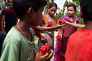 Members of the Kishuri Sachetana Child Club gather to welcome Save The Children UK before commencing their regular meeting in their activity center in Thahuri Tole, Chhinchu, Surkhet district, Western Nepal, on 1st July 2012. These Child Clubs, supported by the government, Save the Children and their local partner NGO Safer Society, advocate for child rights and against child marriages and use peer support and education to end child marriages and raise awareness. Photo by Suzanne Lee for Save The Children UK