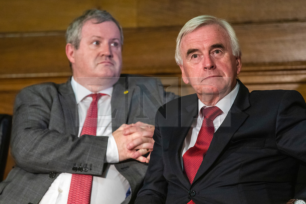 © Licensed to London News Pictures. 27/08/2019. London, UK. SNP Westminster Leader Ian Blackford (L) and Shadow Chancellor John McDonnell (R) at an event at Church House. MPs and party leaders have signed the 'Church House Declaration' to assert their commitment to avoiding a no deal exit from the EU. Photo credit: Rob Pinney/LNP