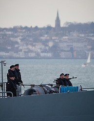 "© Licensed to London News Pictures. 09/01/2017. Portsmouth, UK.  Sailors standing on the bow of the Polish Navy's youngest ship, ORP Kontradmiral Xawery Czernicki, ""Czernicki"", as she sails into Portsmouth Harbour under Police escort this morning, 9th January 2017. The multi-role support ship is visiting Portsmouth before deploying on a 6-month mission to join Standing NATO Maritime Group 2 (SNMG2) in the Mediterranean Sea. Photo credit: Rob Arnold/LNP"