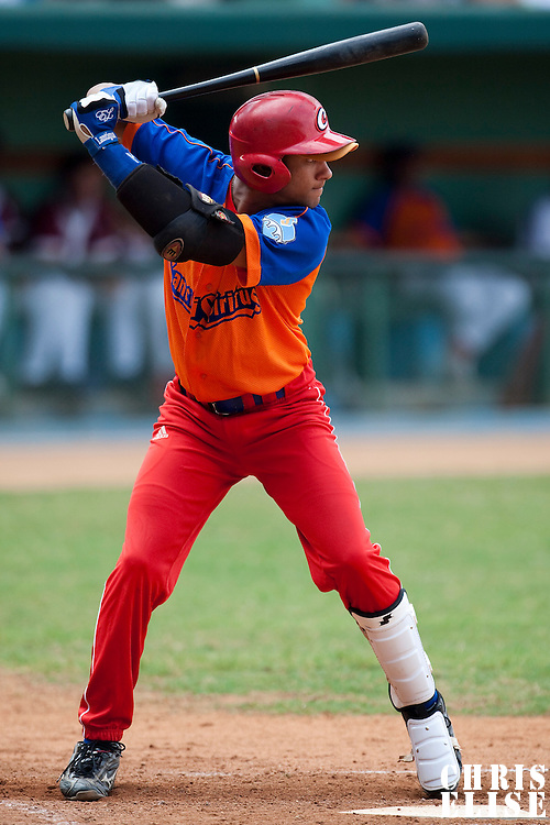 15 February 2009: Third base Yulieski Gourriel is seen at bat during a training game of Cuba Baseball Team for the World Baseball Classic 2009. The national team is pitted against itself, divided in two teams called the Occidentales and the Orientales. The Orientales win 12-8, at the Latinoamericano stadium, in la Habana, Cuba.