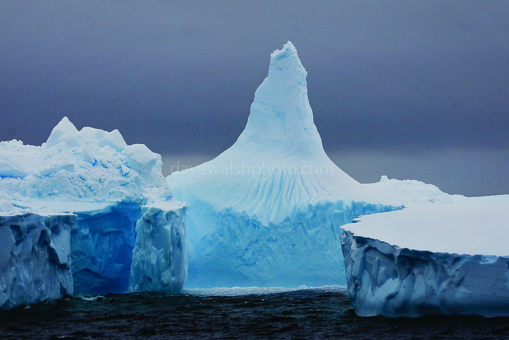 Pointed Iceberg in the Southern Ocean, with a mysterious mood to it. Taken from on board the Greenpeace ship Esperanza, during expedition to find Japanese whaling fleet.