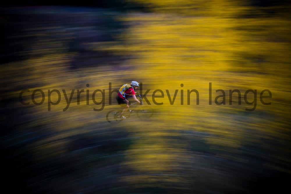 rider lisa lieb partakes of rocky mountain autumn perfection.  hermosa creek trail, durango, colorado.
