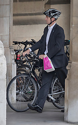 © Licensed to London News Pictures. 30/06/2016. London, UK. Health Secretary Jeremy Hunt is seen on his bike at Parliament after announcing that he would not stand for the leadership after Boris Johnson announced he would not be standing for Conservative party leader.  Photo credit: Peter Macdiarmid/LNP