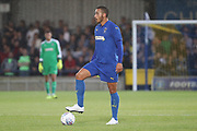AFC Wimbledon defender Rod McDonald (4) with foot on ball during the Pre-Season Friendly match between AFC Wimbledon and Crystal Palace at the Cherry Red Records Stadium, Kingston, England on 30 July 2019.