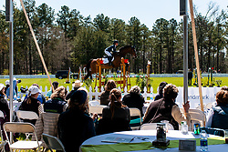 March 22, 2019 - Raeford, North Carolina, US - March 22, 2019 - Raeford, N.C., USA - Patrons watch as a horse and rider competes in the show jumping CCI-4S division at the sixth annual Cloud 11-Gavilan North LLC Carolina International CCI and Horse Trial, at Carolina Horse Park. The Carolina International CCI and Horse Trial is one of North AmericaÃ•s premier eventing competitions for national and international eventing combinations, hosting International competition at the CCI2*-S through CCI4*-S levels and National levels of Training through Advanced. (Credit Image: © Timothy L. Hale/ZUMA Wire)