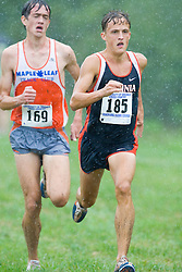 Trey Miller (185/University of Virginia) leads  Emil Heineking (169/Unattached) in the home stretch towards the finish. The Lou Onesty Invitational Cross Country meet was hosted by the University of Virginia XC team and held at Panorama Farms near Charlottesville, VA on September 6, 2008.  Athletes endured rain and wind from Tropical Storm Hanna during the race.