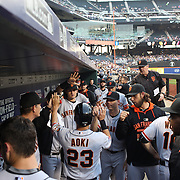 Nori Aoki, San Francisco Giants, celebrates with team mates on his return to the dugout after scoring a run during the New York Mets Vs San Francisco Giants MLB regular season baseball game at Citi Field, Queens, New York. USA. 11th June 2015. Photo Tim Clayton