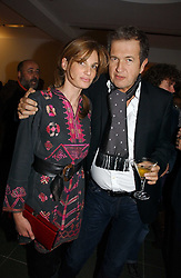 JEMIMA KHAN and MARIO TESTINO at a party to celebrate the 90th birthday of Vogue magazine held at The Serpentine Gallery, Kensington Gardens, London on 8th November 2006.<br />