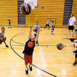 062911       Brian Leddy.Raython Chee tosses a ball towards the basket during the Gallup Boys Basketball Camp on Wednesday.