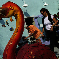 (02.02.2005)(PHOTO/CHIP LITHERLAND) -- Jim Lavaty, left to right, Teri Bennett, and Marcia Brewer, all of Anna Maria, hang out on the color saturated patio of Tropical Treats & Eats in the city of Anna Maria, Florida, Wednesday morning.