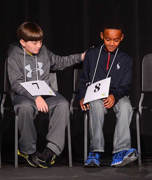 Gary Cosby Jr./Decatur Daily   Spencer Lott from Oak Park Middle School congratulates Jalen Orr from Julian Harris Elementary after he spelled a word correctly during the Morgan County Spelling Bee at Hartselle High School Thursday afternoon.