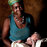 Tachira Muntaru, approximately 70, is the leader of the women at the Gambaga camp for alleged witches. If everyone else says she is a witch, she says, then she must be. She is pictured with her grandson, born in her hut t the camp just minutes before this photograph was taken.