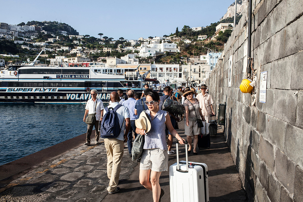 04 August 2017, Capri Italy - Tourists departure and arrival in the morning at the port of the Capri Island.