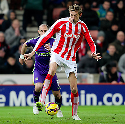Stoke City's Peter Crouch controls the ball - Photo mandatory by-line: Matt McNulty/JMP - Mobile: 07966 386802 - 11/02/2015 - SPORT - Football - Stoke - Britannia Stadium - Stoke City v Manchester City - Barclays Premier League